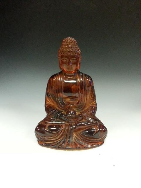 AN CHINESE CARVED BUDDHA.