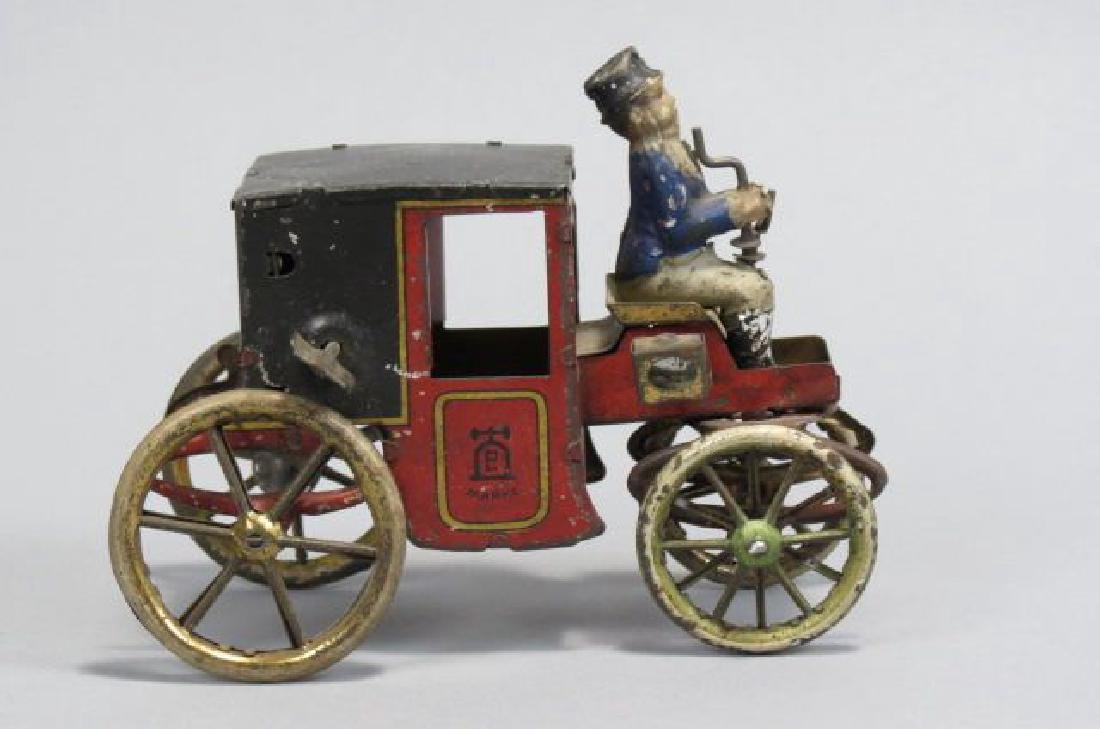 Early Tin Wind-up Toy Horseless Carriage,