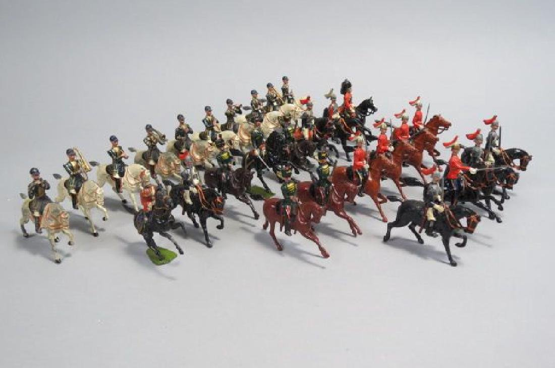 28 Miniature Lead Soldiers on Horseback by Britain