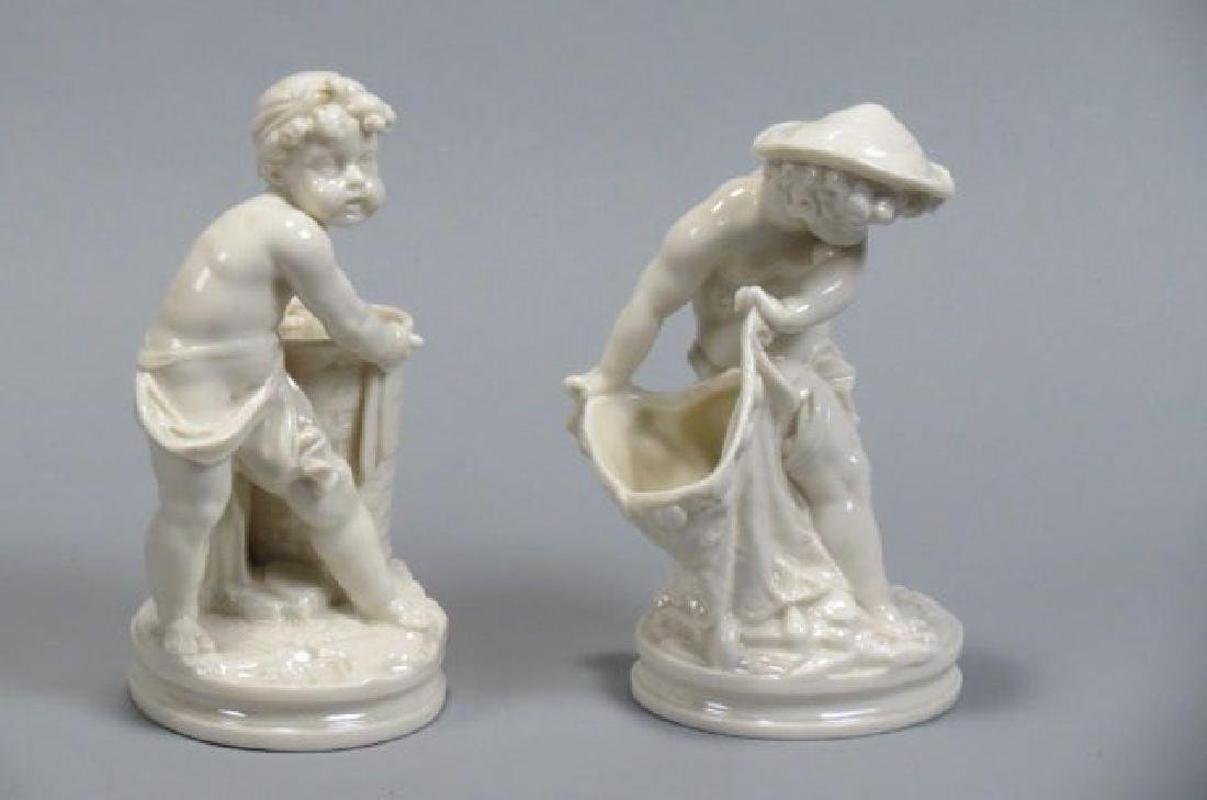 Pair of Royal Worcester Figural Vases,