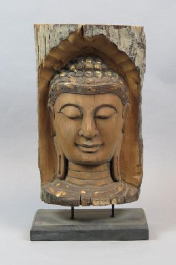 Carved Wooden Bust of a Buddha,