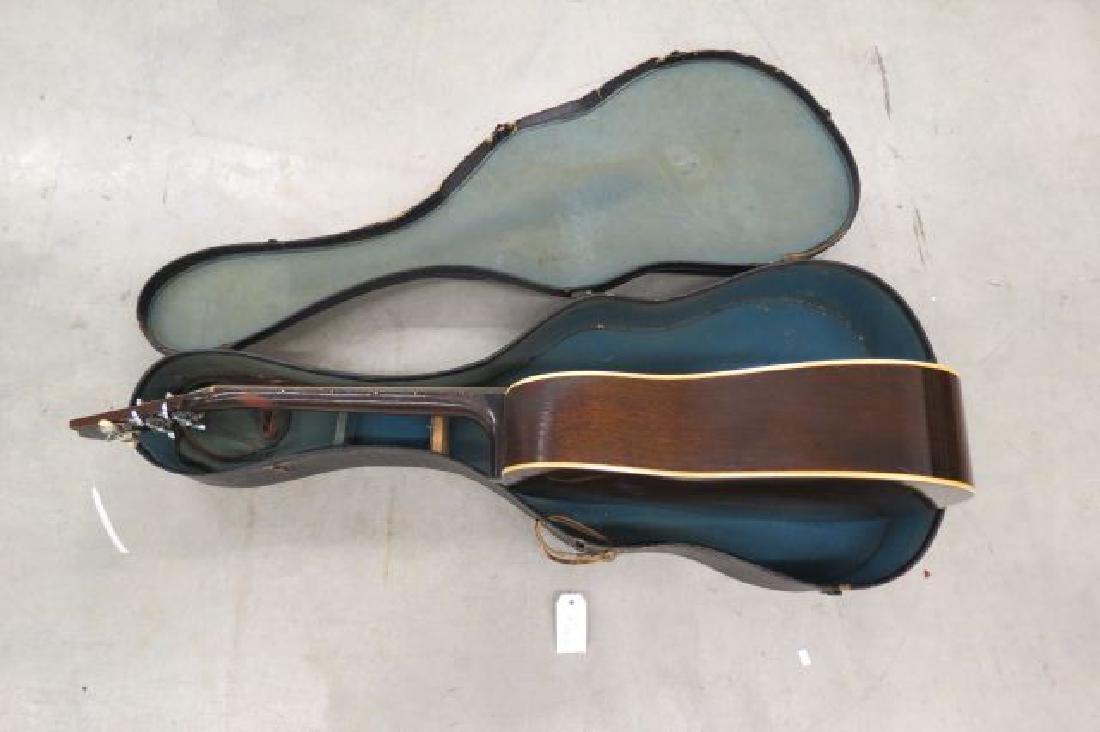 Gibson Guitar, - 3