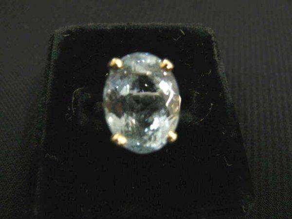 510: Blue Topaz Ring, 12 carat oval rich blue gem in 14
