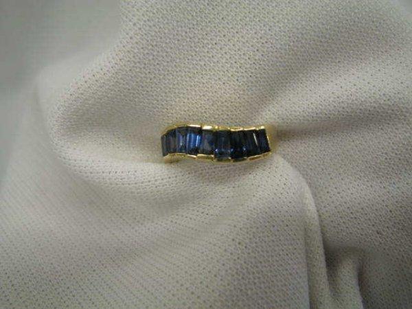 511: Sapphire Ring, fancy channel set rich blue baguett
