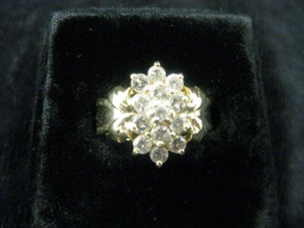 10: Diamond Ring, fine cluster of high grade round diam