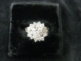 11: Diamond Ring, fine cluster of round diamonds totali