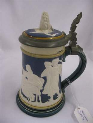 16: Mettlach Pottery Stein, relief scene of people dini