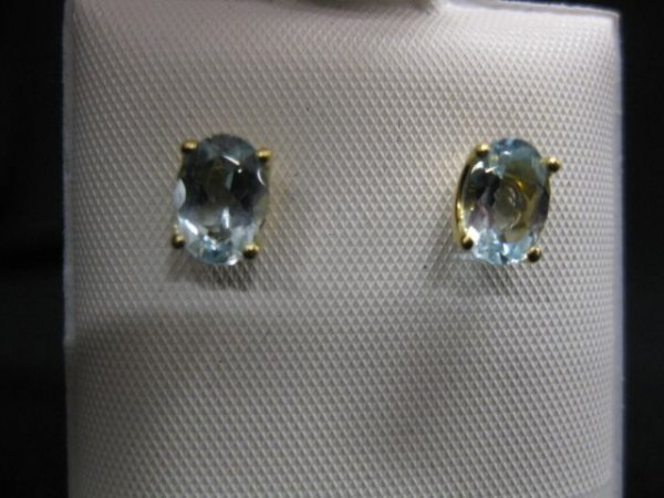 11A: Aquamarine Earrings, each with a 1 carat oval gem