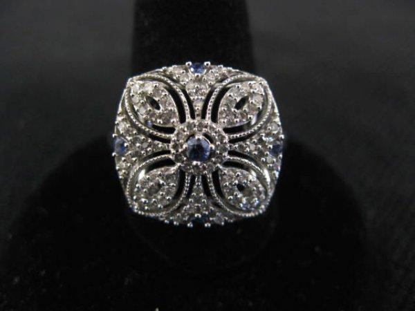 11: Diamond & Sapphire Ring, five rich blue round