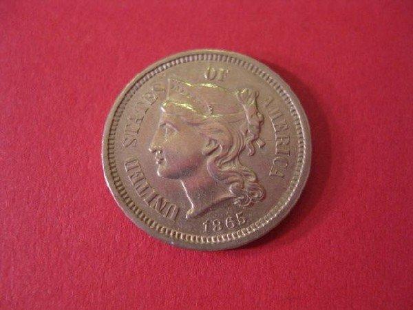 21: 1865 Three Cent Nickel, uncirculated.