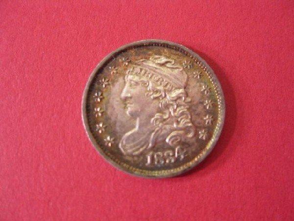 22: 1834 U.S. Half Dime, capped bust, uncirculated.