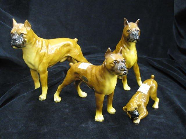 7: 4 Morton Studio's Boxer Figurines, various size dogs