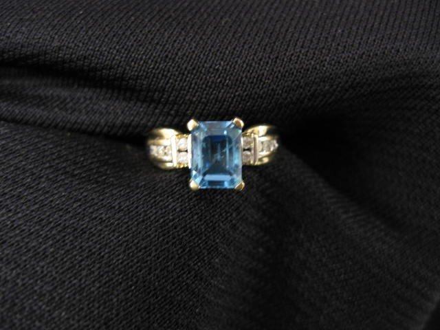 10: Blue Topaz & Diamond Ring, 3 carat emerald cut gem