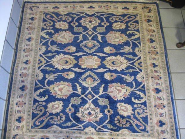 14: Oushak Persian Handmade Rug, flowering vine on blue