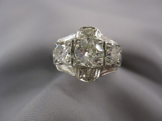 614: Diamond Ring, .70 center stone and 4 other stones