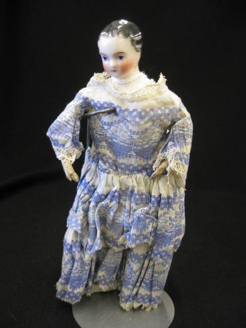 "7: Victorian China Head Doll, kid body, 7 3/4""."