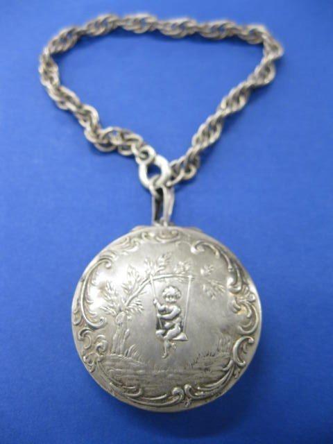 10: Sterling Silver Pill Case & Bracelet, scene of chil