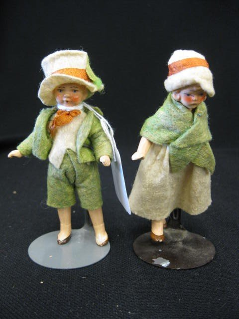 14: Pair of German Bisque Dolls, boy & girl in felt out