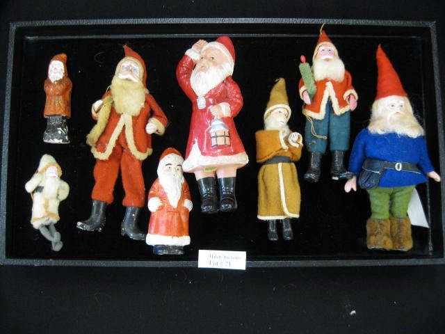 21: Collection of 8 Antique Santa Figurines, includes b