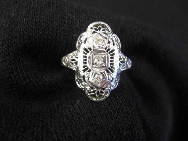 10: Diamond Filigree Ring, trio of small diamonds