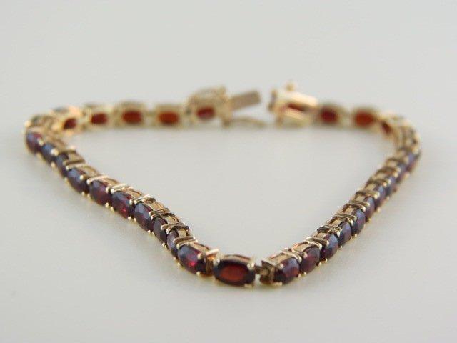 11: Garnet Tennis Bracelet,