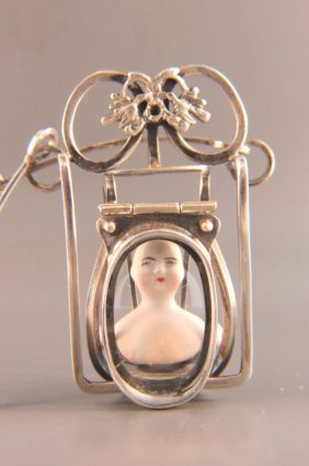 Artisan Sterling And Doll Head Necklace,
