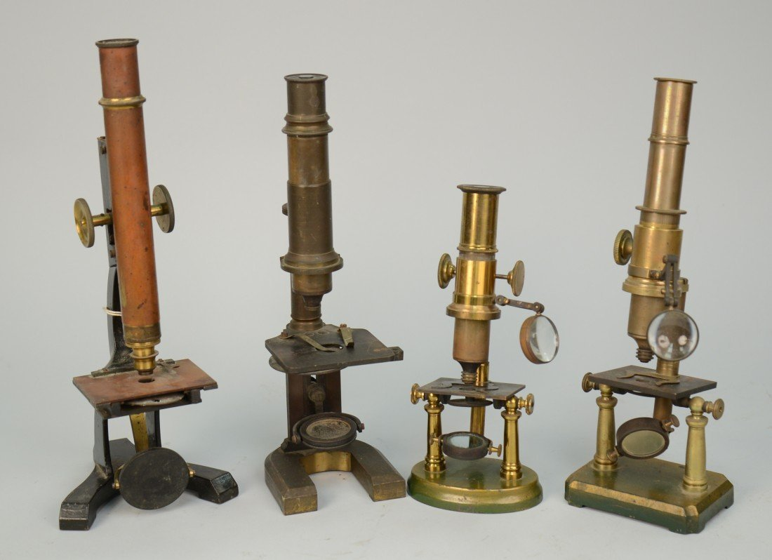 """FOUR MICROSCOPES, one bearing tag """"early and primitive"""