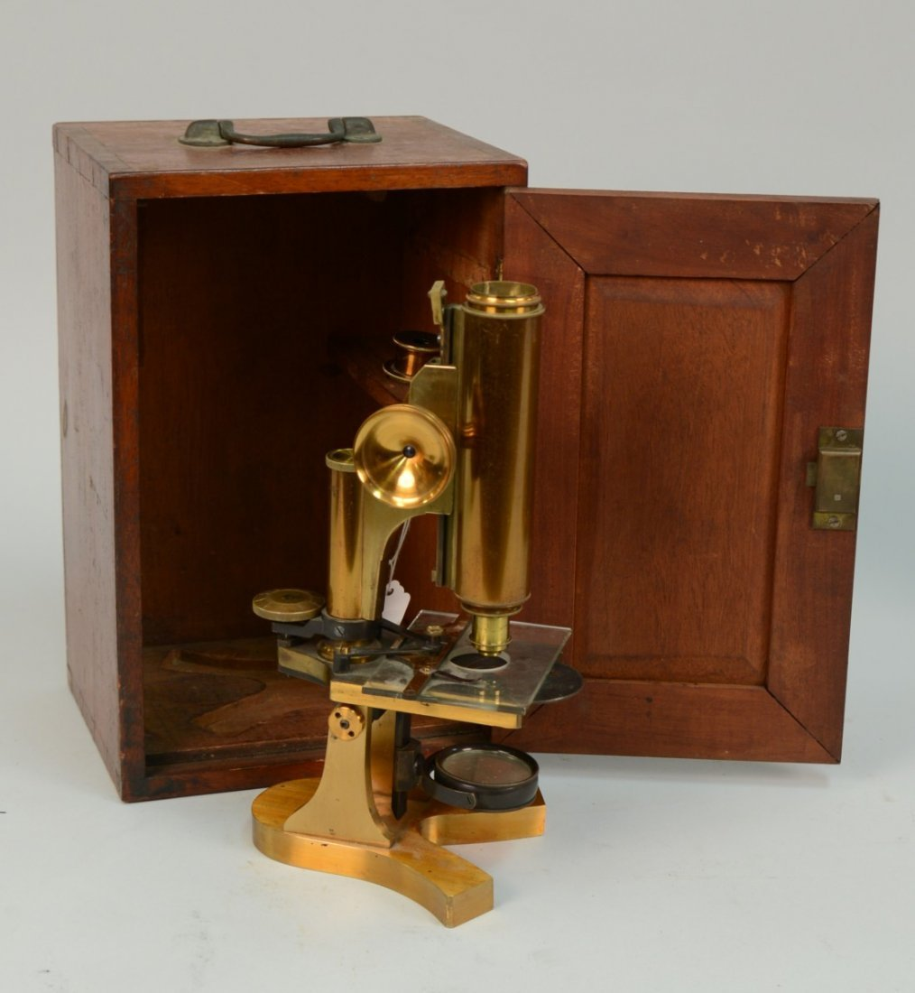 DOUBLE PILLAR BRASS MICROSCOPE; unmarked; in fitted box