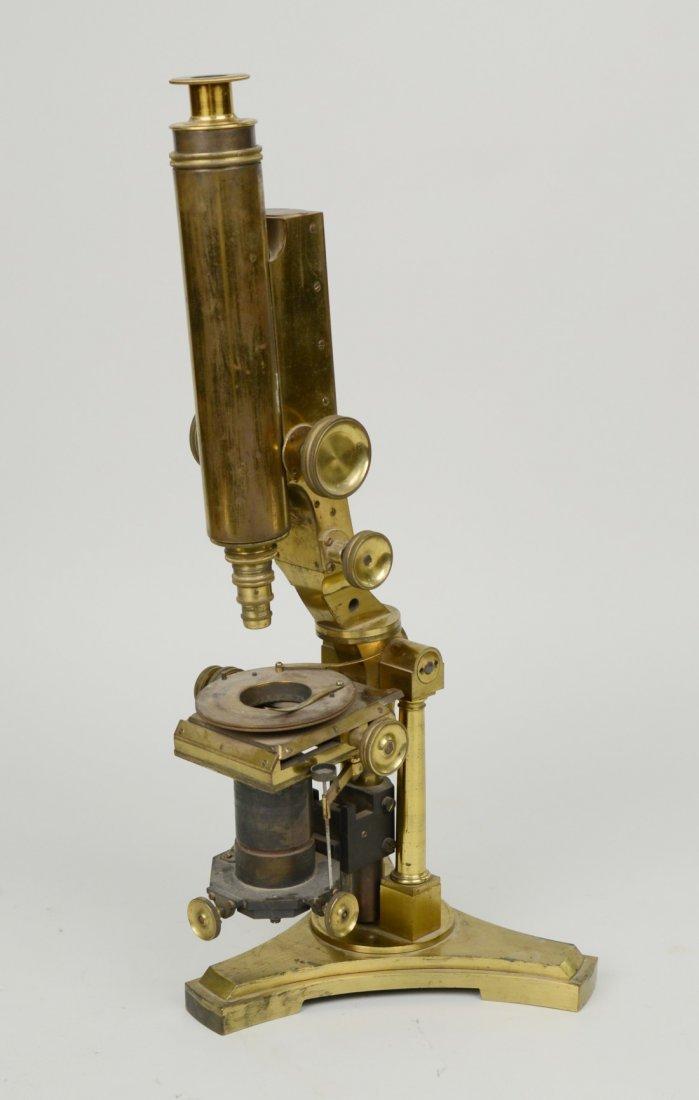 BRASS MICROSCOPE; marked Powell & Lealand, London, 1842