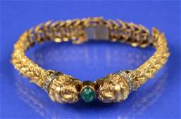 18K YELLOW GOLD, DIAMOND, AND EMERALD LION HEAD