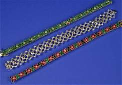 TWO 14K YELLOW GOLD DIAMOND AND GEMSET BRACELETS and