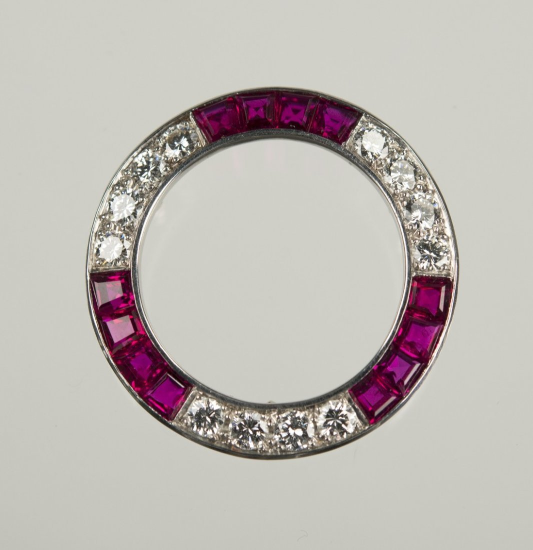 18K WHITE GOLD, DIAMOND, AND RUBY CIRCLE BROOCH