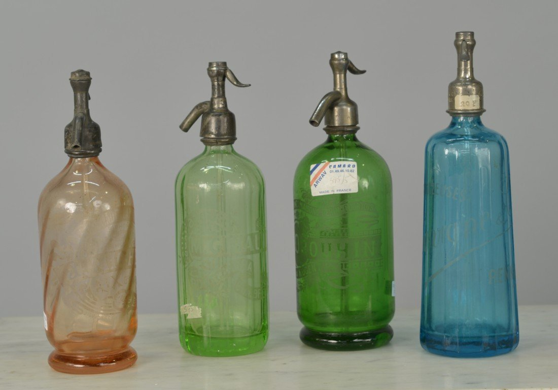 FOUR FRENCH COLORED AND ETCHED GLASS SODA BOTTLES;