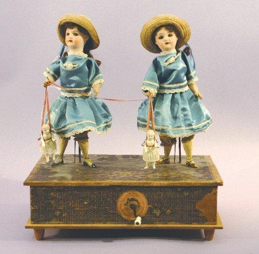 Antique German Bisque Mechanical Twin Dolls