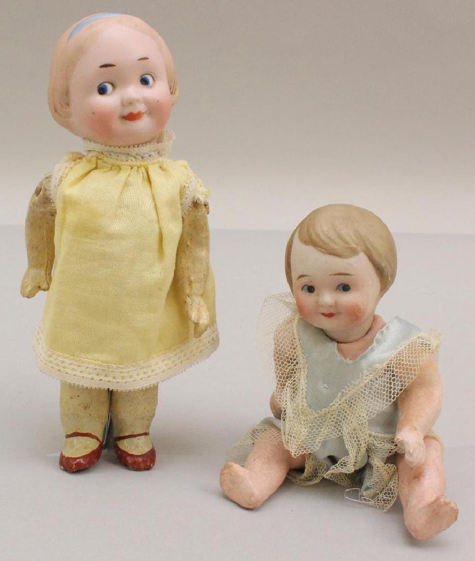 PAIR OF ANTIQUE BISQUE HEAD PAINTED EYE GOOGLY DOLLS.
