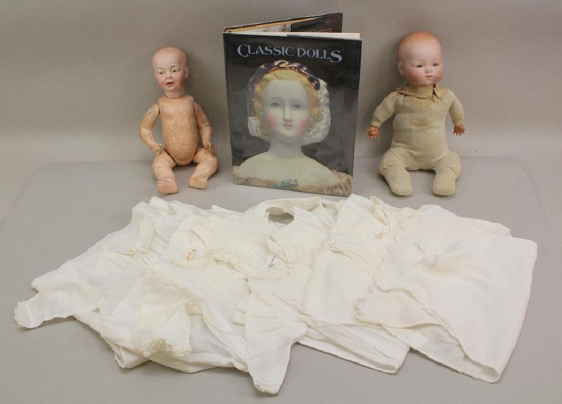 LOT: PAIR OF ANTIQUE BISQUE SOLID DOME HEAD BABY DOLLS;