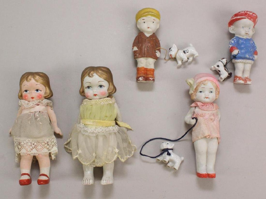 LOT OF (5) ALL BISQUE JAPANESE MADE IMMOBILE DOLLS.