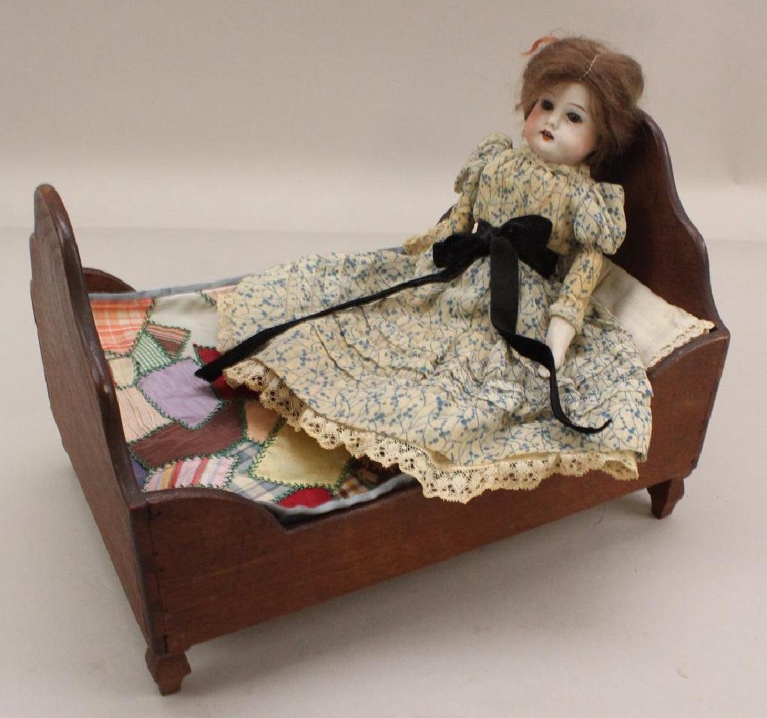 """LOT: 10 1/2"""" AM 3700 AND WOODEN DOLL BED MADE IN 1870"""