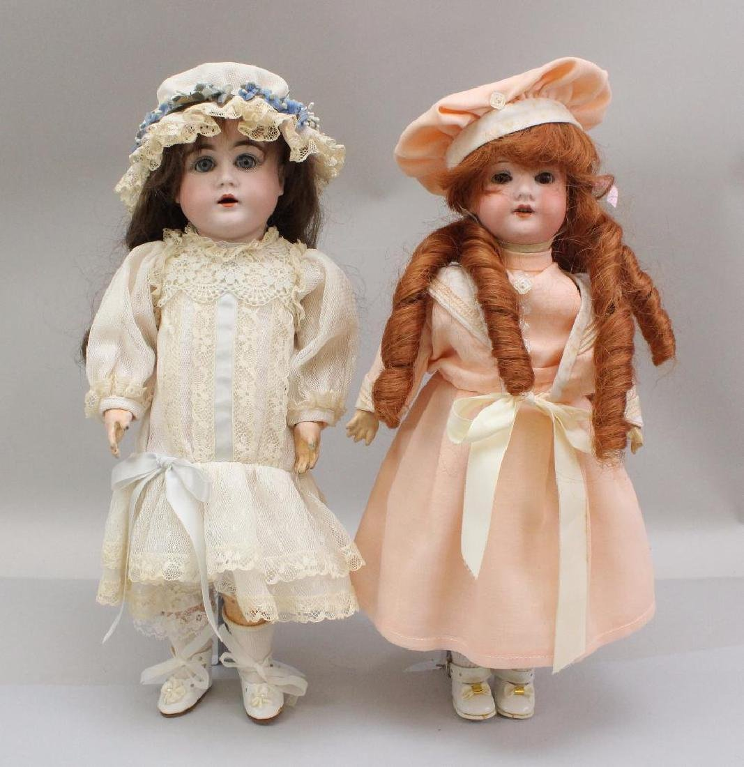 """PAIR OF ANTIQUE BISQUE HEAD DOLLS: 14"""" D MADE IN"""