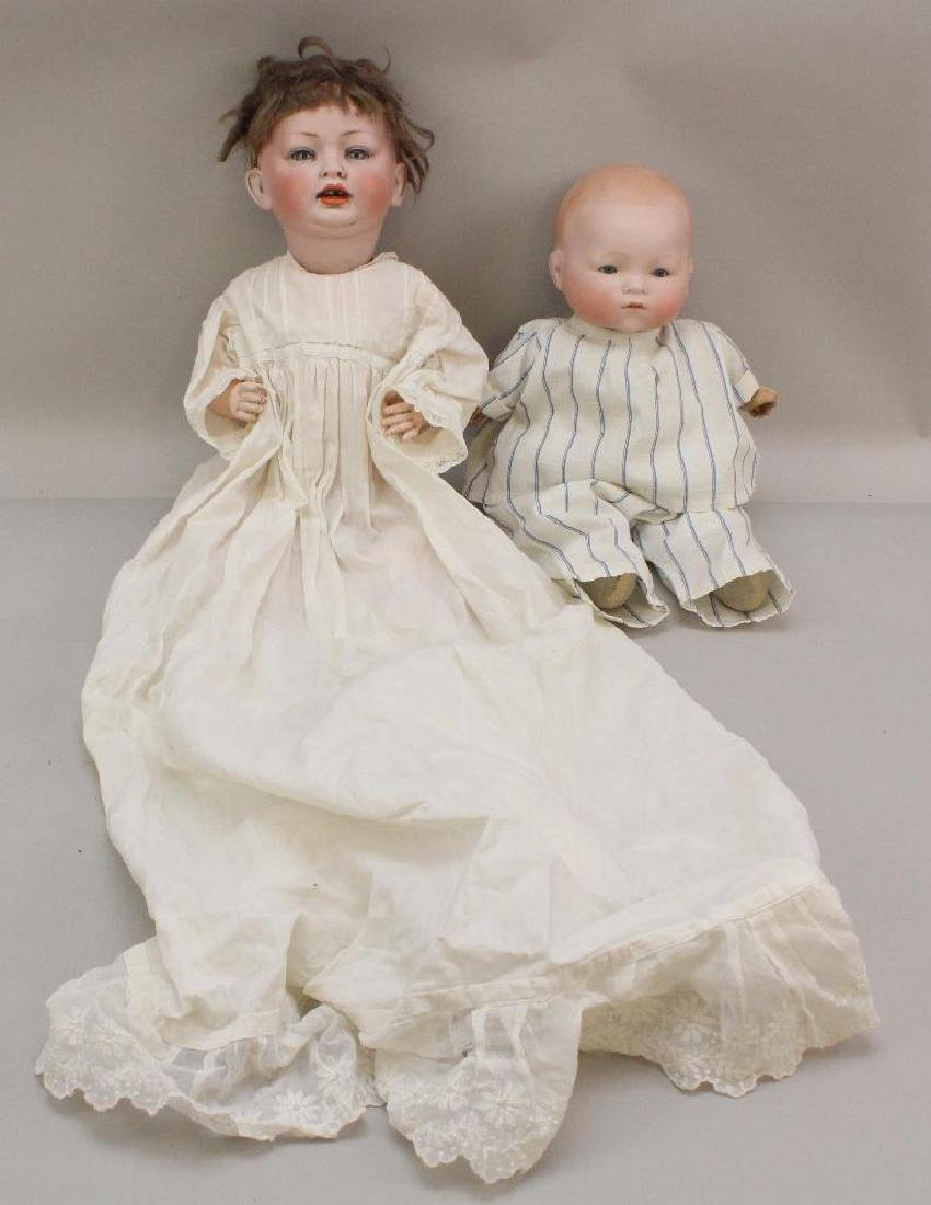 PAIR OF ANTIQUE BISQUE HEAD BABY DOLLS: 152 & AM 341.