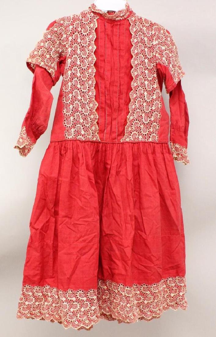 CHILD'S ANTIQUE RED COTTON DRESS WITH HAND EMBROIDERED