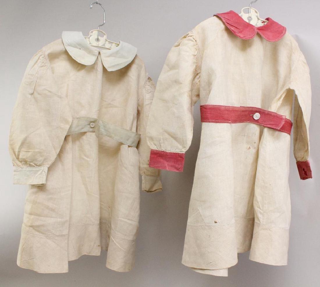 PAIR OF ANTIQUE CHILDREN'S MATCHING DRESSES.