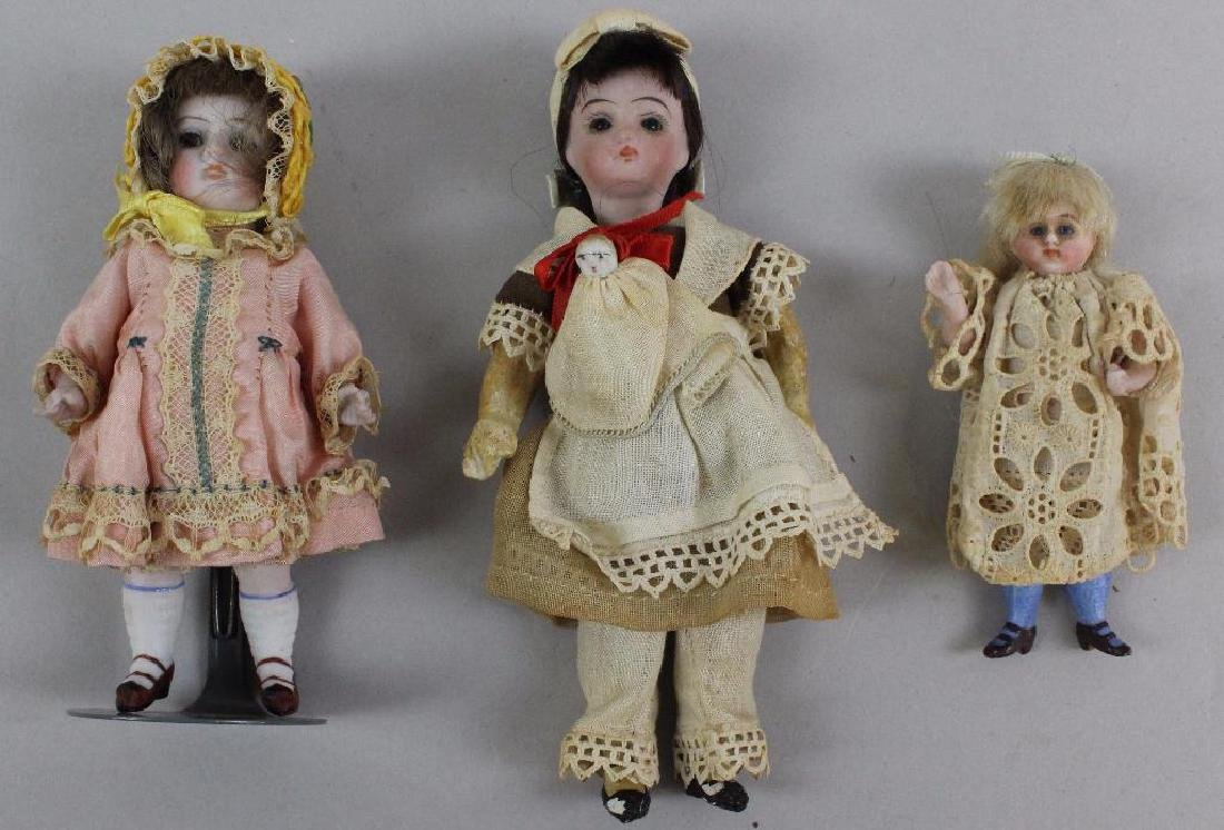 "LOT OF (3) DOLLS WITH GLASS EYES: 3 1/2"", 5"", 5 1/2""."