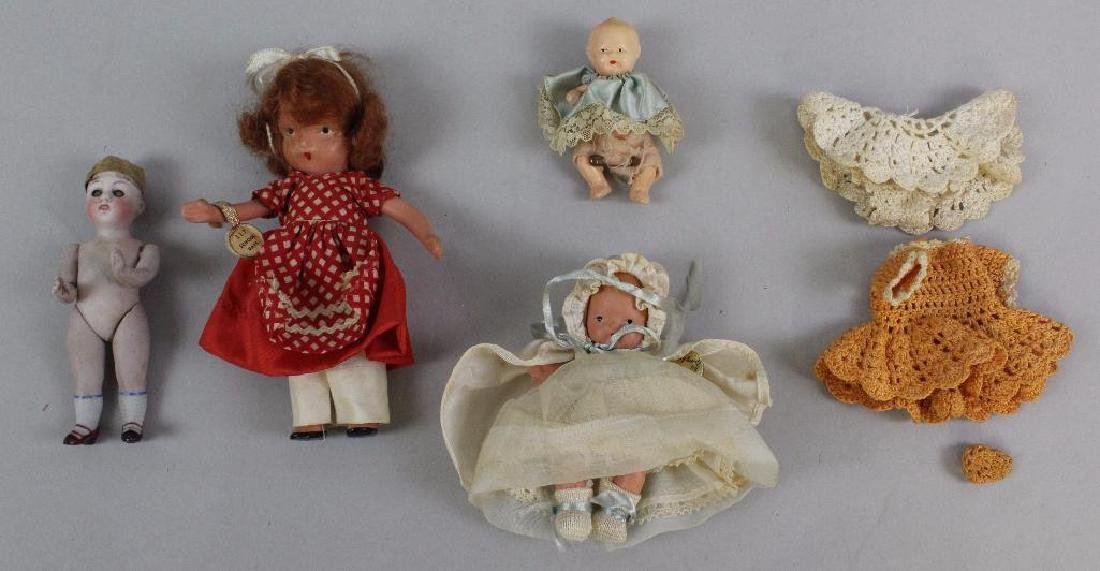 LOT OF (4) ALL BISQUE & PAINTED BISQUE DOLLS.