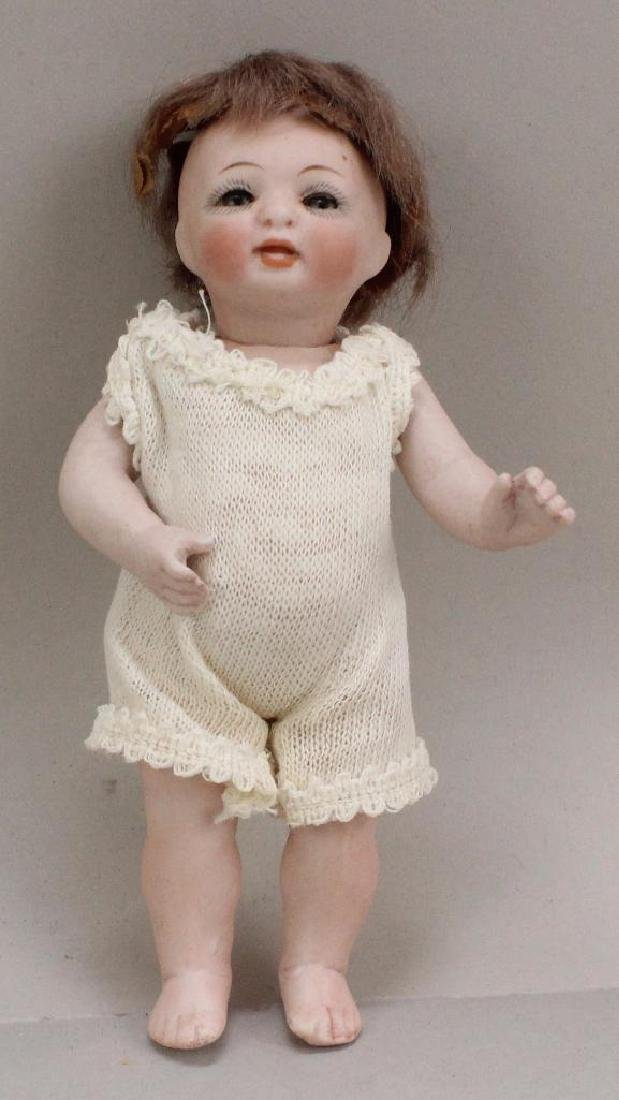 "5""  178 4 1/0 ANTIQUE ALL BISQUE CHARACTER TODDLER."