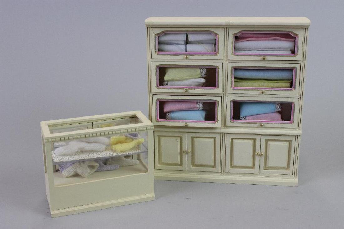 Tall display case and Display case, knitted baby items