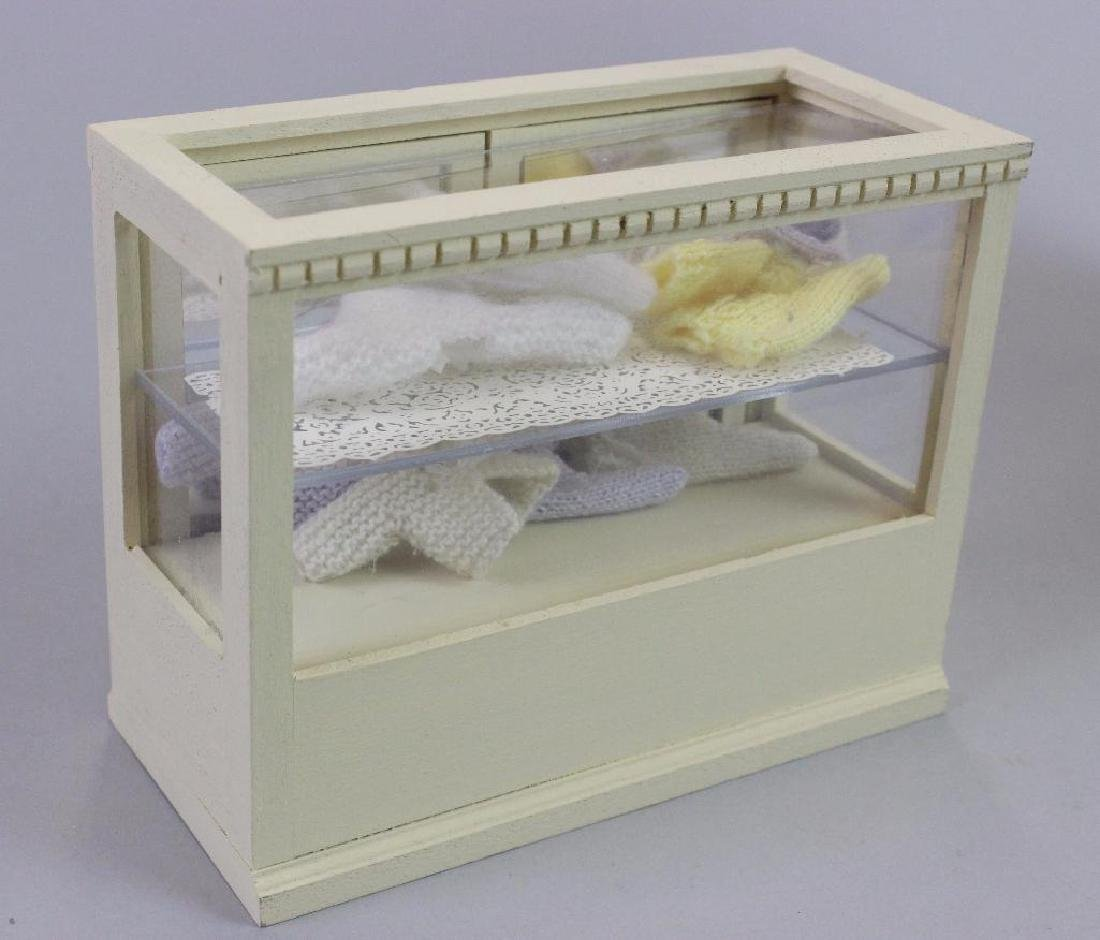 Tall display case and Display case, knitted baby items - 3