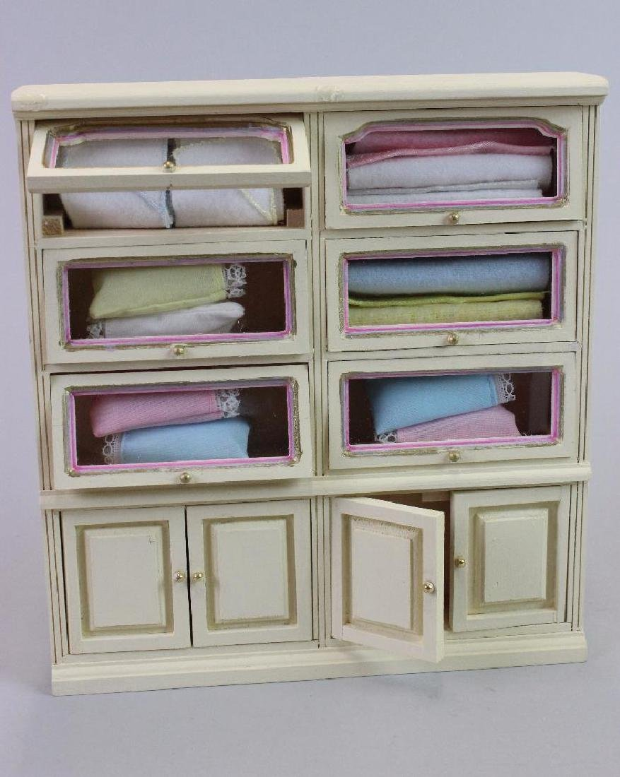 Tall display case and Display case, knitted baby items - 4