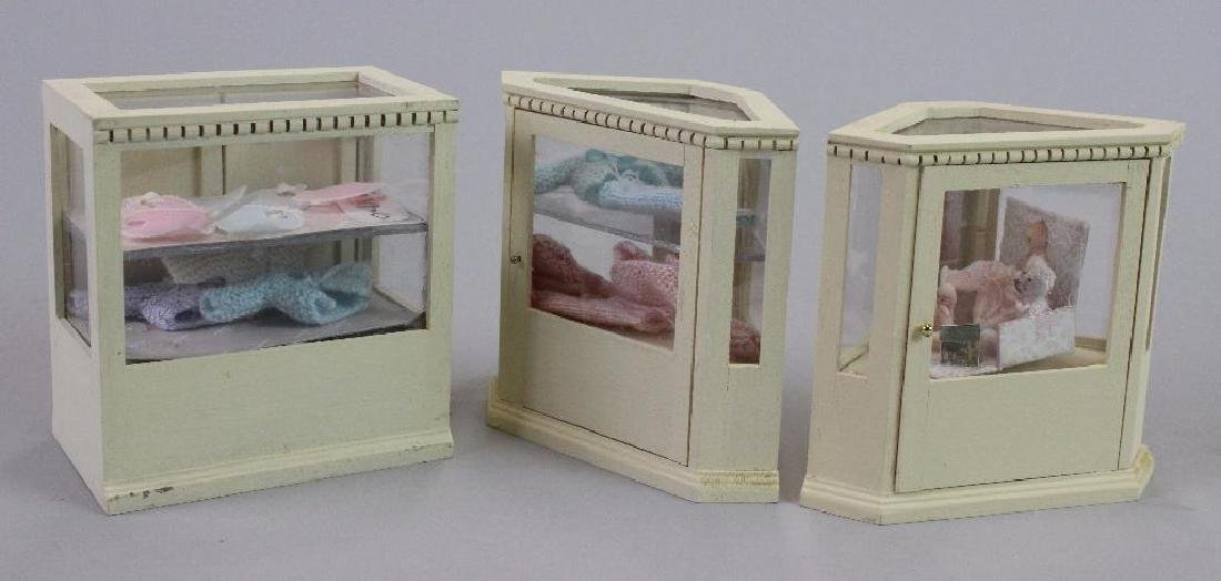 Corner & Display cases, painted bibs, knitted items