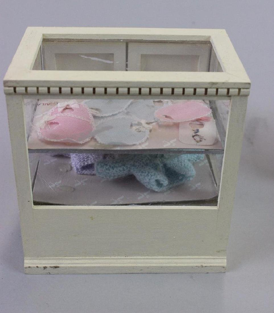 Corner & Display cases, painted bibs, knitted items - 3